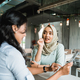 a hijab woman order food and drink to waitress - PhotoDune Item for Sale