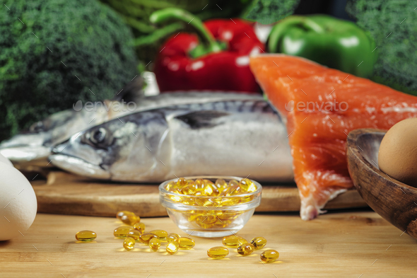 Vitamin D Gel Capsules and Natural Sources of Vitamin D - Stock Photo - Images