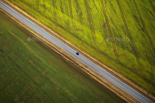 View from the height on the car driving along a rural road betwe - Stock Photo - Images