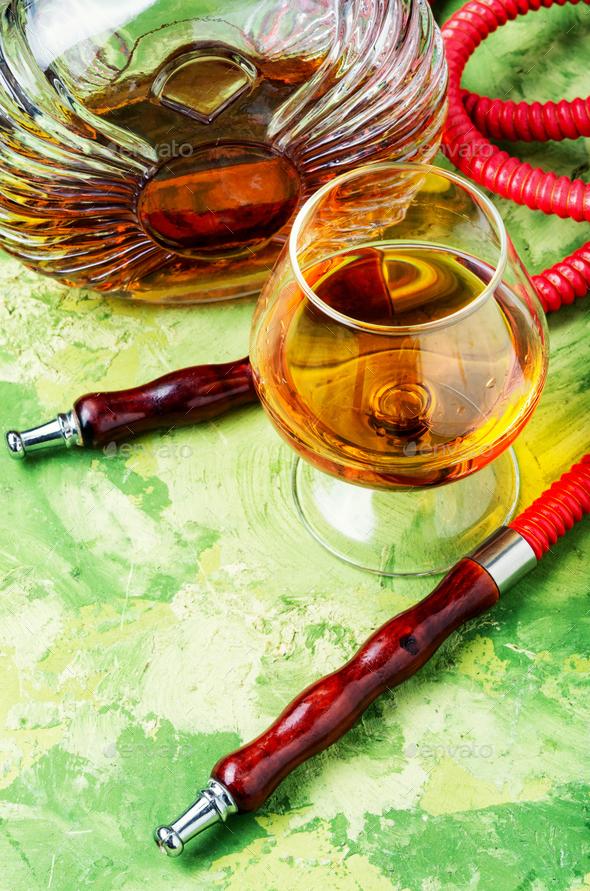 Smoking hookah with cognac flavor - Stock Photo - Images