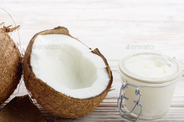 Background of coconut, coconut shell, hard oil in airtight glass - Stock Photo - Images