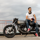 Brutal man sit on cafe racer custom motorbike. - PhotoDune Item for Sale
