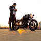 Brutal man near his cafe racer custom motorbike. - PhotoDune Item for Sale