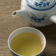Cup with Japanese green tea and teapot - PhotoDune Item for Sale