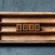 2020 new year retro style card. Two thousand and twentieth year number, wooden cubes in box shelf - PhotoDune Item for Sale