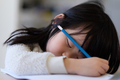 Asian young child fall asleep during study - PhotoDune Item for Sale