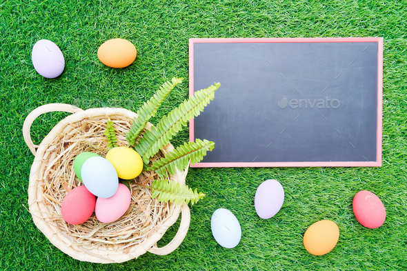 Close up Easter eggs on grass and blackboard mockup-2 - Stock Photo - Images