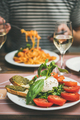 Italian dinner at bistrot with caprese and pasta - PhotoDune Item for Sale