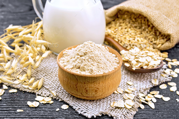 Flour oat in bowl on board - Stock Photo - Images