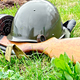 Helmet and submachine gun on grass - PhotoDune Item for Sale