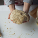 Woman kneading dough on kitchen table - PhotoDune Item for Sale