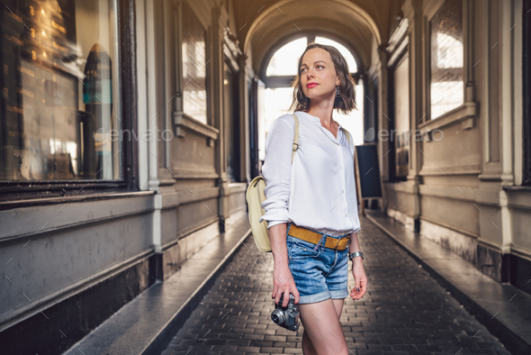 Attractive girl with a retro camera - Stock Photo - Images