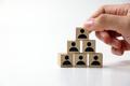 Businessman stacking wooden team blocks - PhotoDune Item for Sale