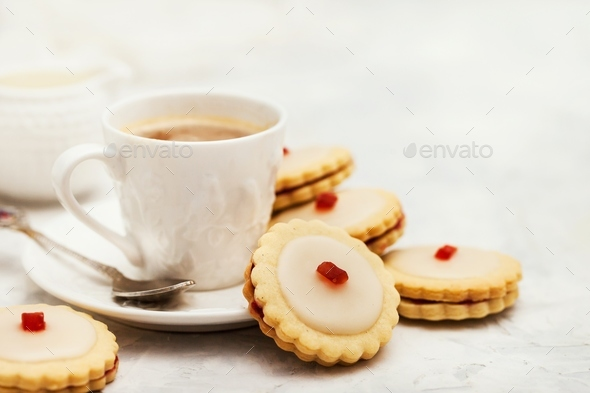 Empire shortbread sandwich cookies and cup of coffee - Stock Photo - Images