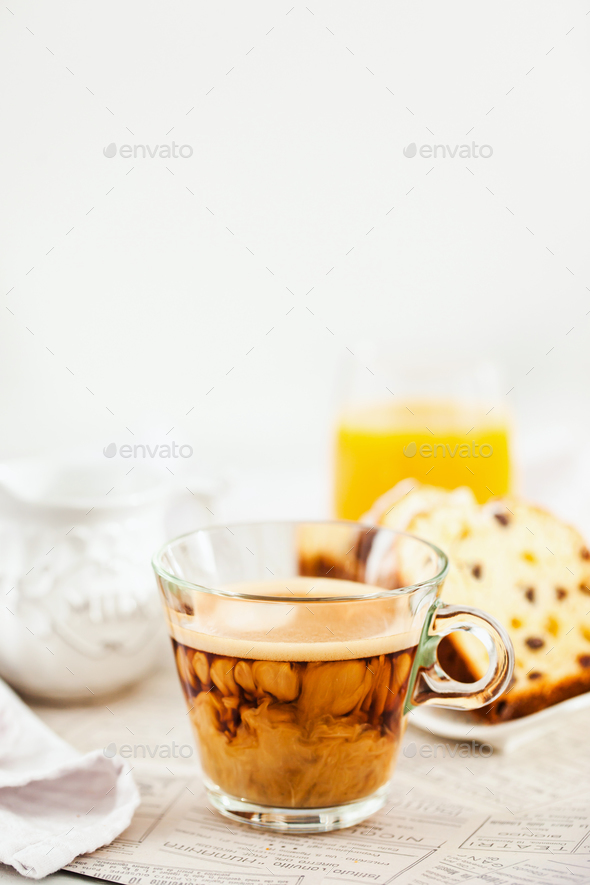 Continental breakfast table with cup of hot  coffee with milk, c - Stock Photo - Images