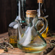 oil jugs with Spanish olive oil and branches of rosemary on rustic wood - PhotoDune Item for Sale