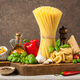 Pasta, spaghetti and ingredients on wooden table - PhotoDune Item for Sale