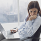Pensive businesswoman working with her laptop - PhotoDune Item for Sale
