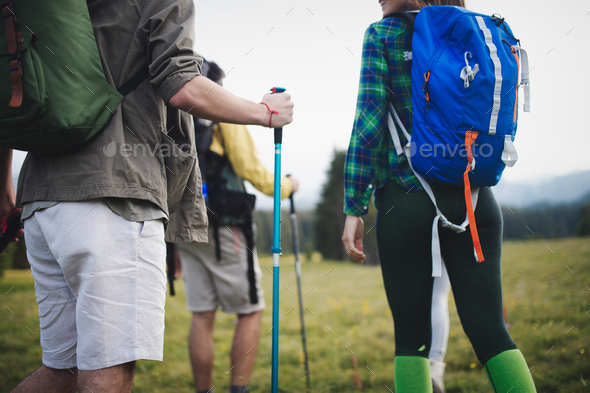 Friends hiking together outdoors exploring the wilderness - Stock Photo - Images
