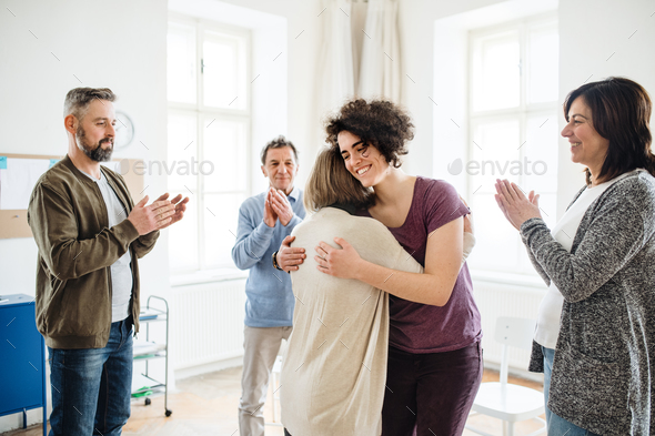Men and women during group therapy, showing a sign of relief. - Stock Photo - Images