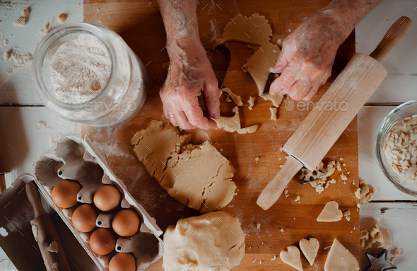 Midsection of old woman making cakes in a kitchen at home. Top view. - Stock Photo - Images