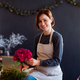 Young creative woman in a flower shop. A startup of florist business. - PhotoDune Item for Sale