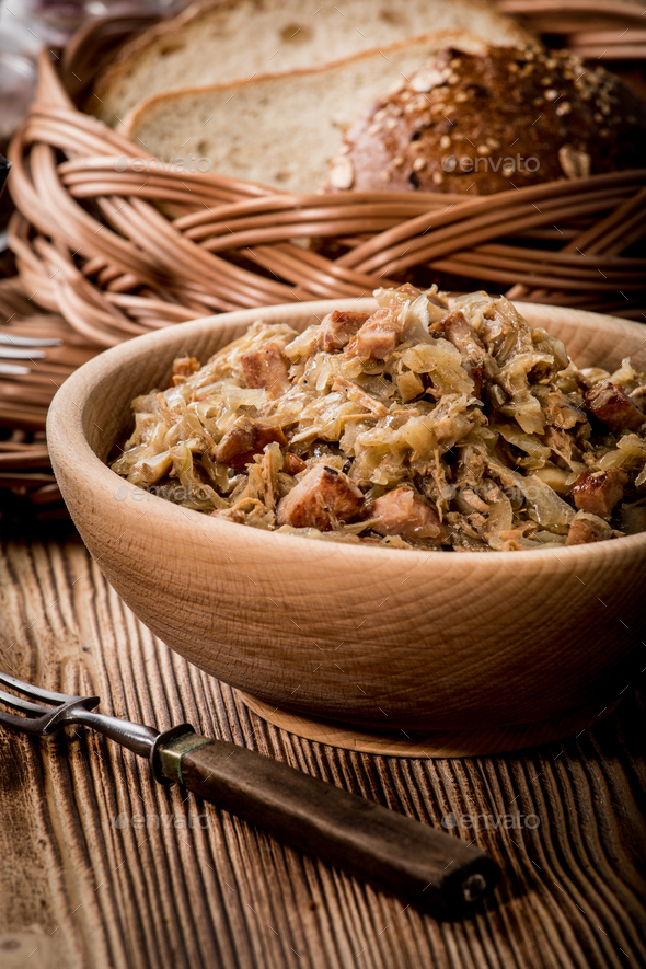Bigos - stewed cabbage with meat,dried mushrooms and smoked sausage. - Stock Photo - Images