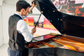 Male pianist opens the lid of black grand piano - PhotoDune Item for Sale