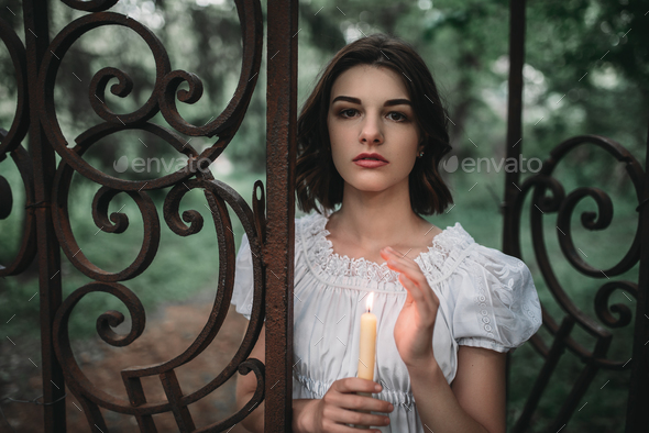 Victim at the gates of old cemetery in forest - Stock Photo - Images