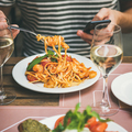 Italian dinner at bistrot with caprese salad and pasta - PhotoDune Item for Sale