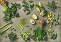 Flat-lay of whole and cut green vegetables and edible herbs - PhotoDune Item for Sale