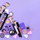 Makeup brush and decorative cosmetics on lilac background. Top v - PhotoDune Item for Sale
