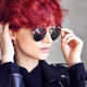 Portrait of a beautiful young red-haired woman wearing sunglasse - PhotoDune Item for Sale