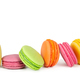 Colorful french macaroons in row isolated on white - PhotoDune Item for Sale