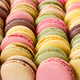 Different colorful french macaroons in a rows. - PhotoDune Item for Sale