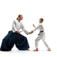 Man and teen boy fighting at aikido training in martial arts school - PhotoDune Item for Sale