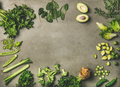 Flat-lay of whole and cut green vegetables and herbs - PhotoDune Item for Sale