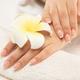 Woman gets manicure procedure in a spa salon. Beautiful female h - PhotoDune Item for Sale
