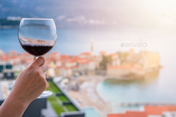 Drinking red wine in Budva - Stock Photo - Images