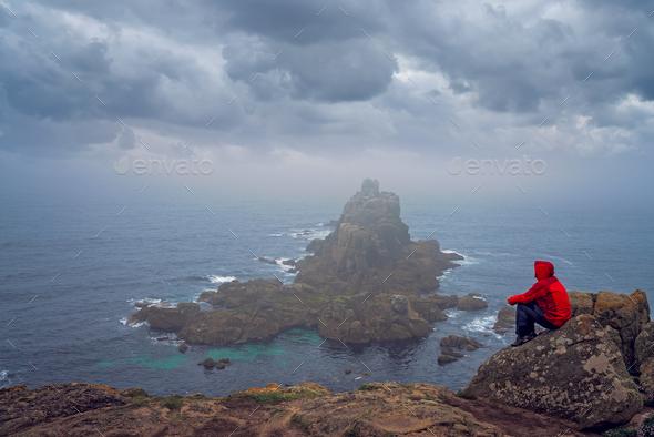 Tourist admiring landscape of Lands End - Stock Photo - Images