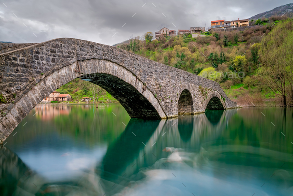 Ancient stone arch bridge  in Rijeka Crnojevica - Stock Photo - Images