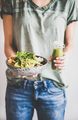 Woman in jeans holding healthy superbowl and smoothie in hands - PhotoDune Item for Sale