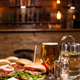 Cold beer with classic burgers on a restaurant wooden table - PhotoDune Item for Sale