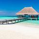 Wooden jetty on blue ocean in Maldives. - PhotoDune Item for Sale