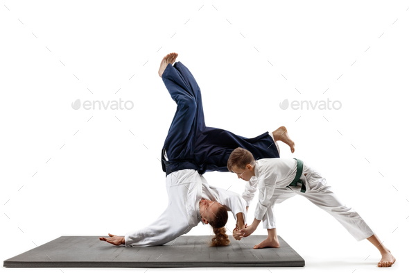 546bc12f03e3a Man and teen boy fighting at aikido training in martial arts school - Stock  Photo -