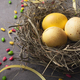Easter background. Colored eggs in nest on gray stone surface - PhotoDune Item for Sale