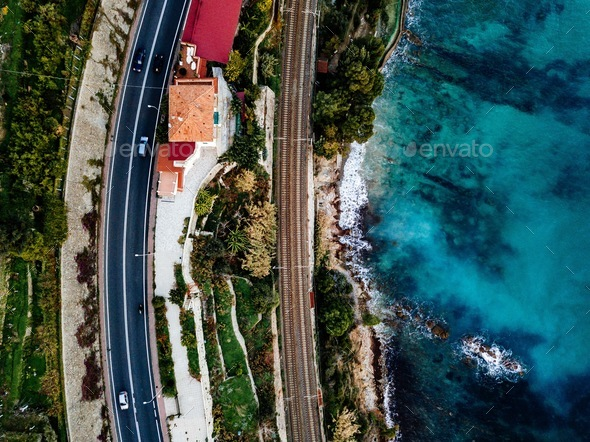 Aerial view of road, highway and railway going along ocean or sea. Drone photography in rural Italy - Stock Photo - Images