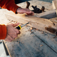worker screw up  wooden rail with a screw with a screwdriver, on table in sawdust - PhotoDune Item for Sale