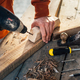 a worker drills a hole in  wooden bar with   drill - PhotoDune Item for Sale