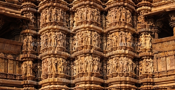 Famous stone carving sculptures of Khajuraho - Stock Photo - Images